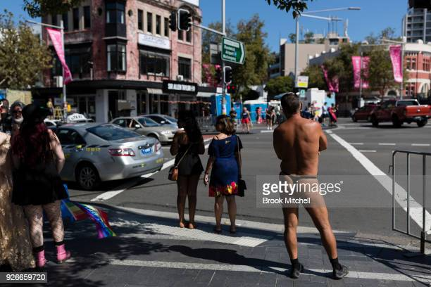 A man waits to cross Oxford Street before the 2018 Sydney Gay Lesbian Mardi Gras Parade on March 3 2018 in Sydney Australia The Sydney Mardi Gras...
