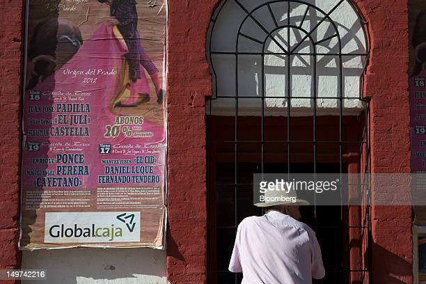 A man waits to purchase tickets for a bullfighting event at a kiosk outside the bullring in Ciudad Real Spain on Thursday Aug 2 2012 The European...
