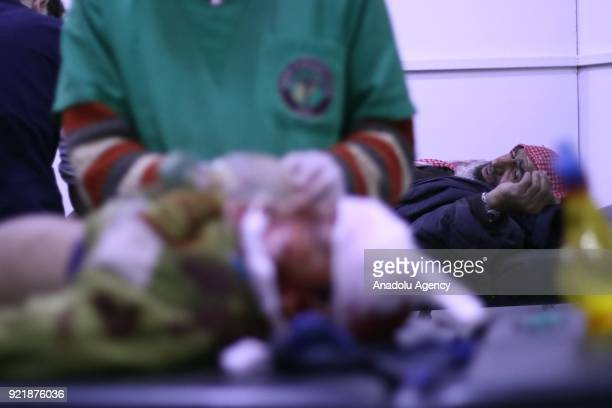 A man waits to receive medical treatment at a field hospital as Assad Regime forces carried out airstrikes over Arbin town of the Eastern Ghouta...