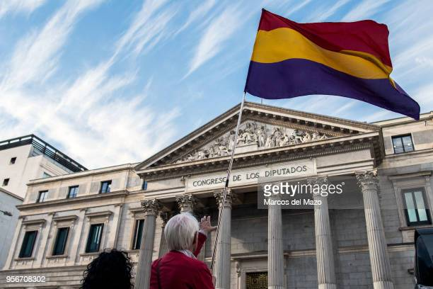 A man waiving a Republican flag protesting in front of the Congress of Deputies against impunity of crimes during Franco's dictatorship coinciding...