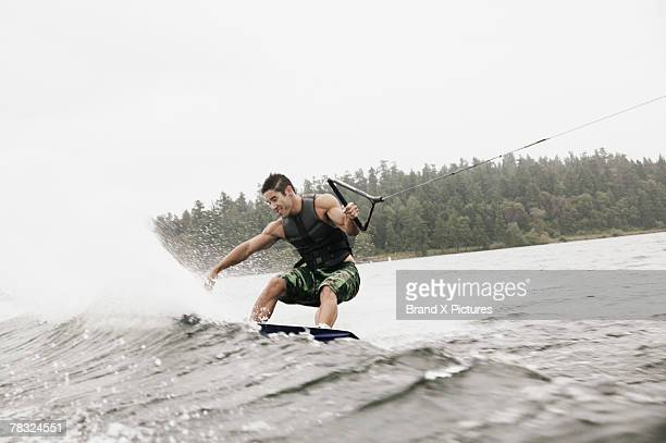 man wake boarding - waterskiing stock photos and pictures
