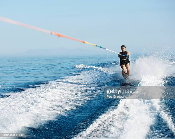 man wakeboarding at sea - waterskiing stock photos and pictures