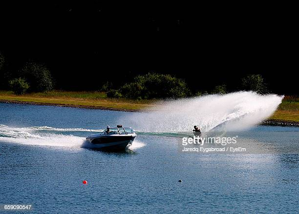 man wakesurfing in lake - waterskiing stock photos and pictures