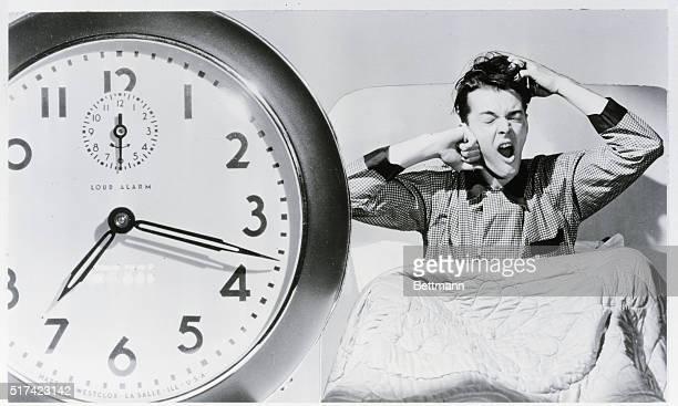 Man waking up to alarm clock Undated Photograph BPA2# 1121