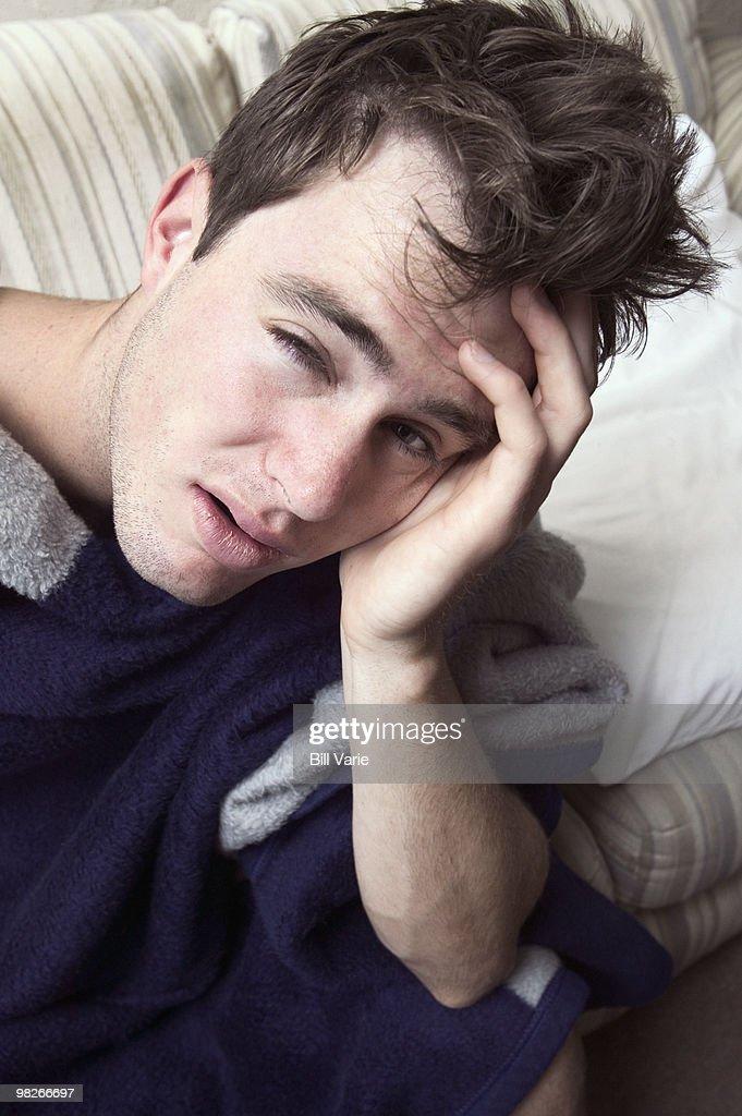 Man waking up with headache : Stock Photo