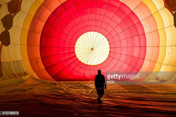 a man walk in the balloon in sunrise - hot air balloon stock pictures, royalty-free photos & images