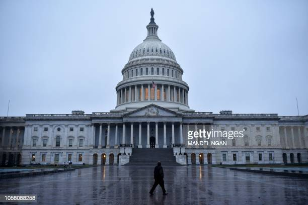 A man walk on November 6 2018 in front of the US Capitol in Washington DC Americans started voting today in critical midterm elections that mark the...
