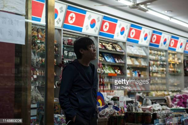Man walk out a store on April 29, 2019 in Dandong, China.The leader of the Democratic People's Republic of Korea , Kim Jong Un, has called for...