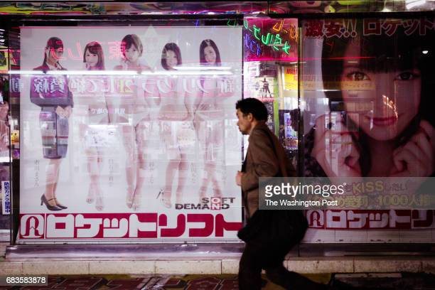 Man walk passes by ad in Akihabara area on March 28, 2017 in Tokyo, Japan.