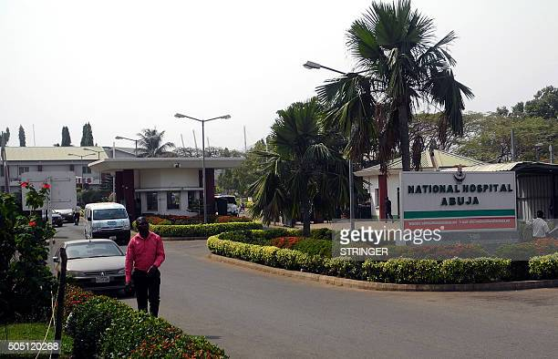 A man walk past signpost of National Hospital in Abuja on January 14 2016 At least 44 people have died from Lassa fever in Nigeria with the death...