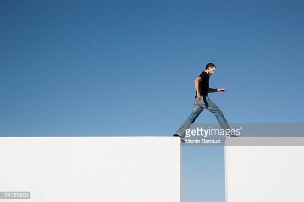Man walking across blocks outdoors
