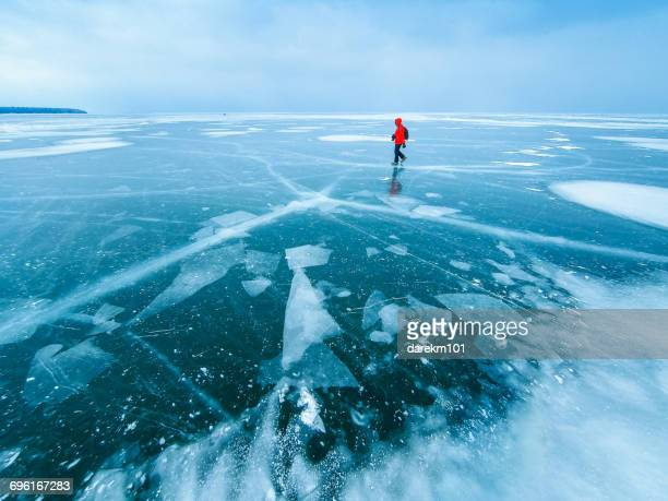 man walking across frozen lake, Apostle Islands, Wisconsin, America, USA