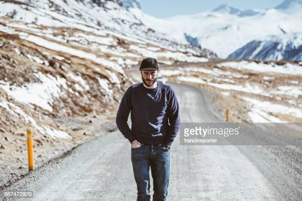 man walking alone in iceland