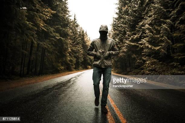 man walking alone in the road