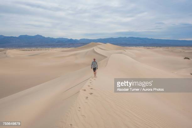 Man walking alone on Mesquite Flat Sand Dunes in Death Valley National Park, California, USA