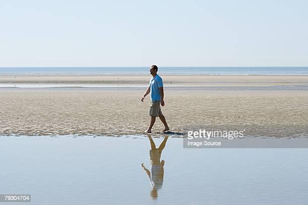 Man walking along a beach