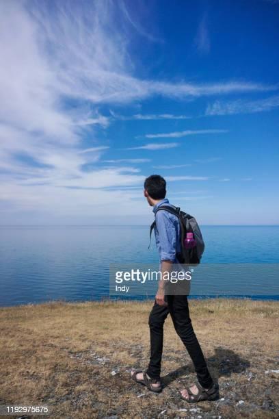 man walking along coastal path, cardigan bay, ceredigion, wales, uk - open toe stock pictures, royalty-free photos & images