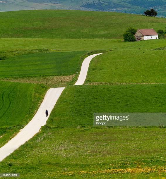 Man Walking Along Country Road