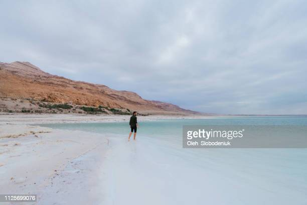 man walking and  resting near dead sea - dead sea stock pictures, royalty-free photos & images