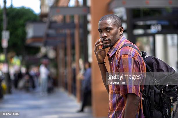 Man Walking and Talking on the Phone in the City