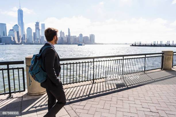 usa, man walking at new jersey waterfront with view to manhattan - riverbank stock pictures, royalty-free photos & images