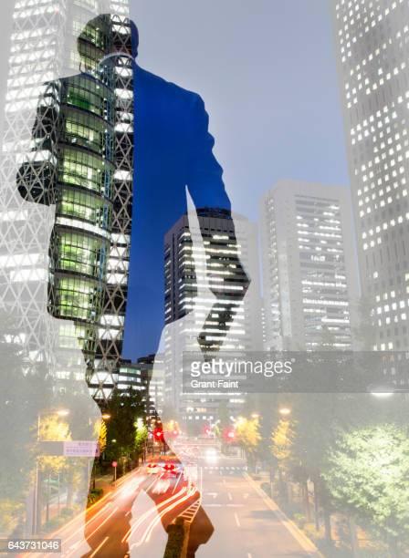 Man walking at office towers.