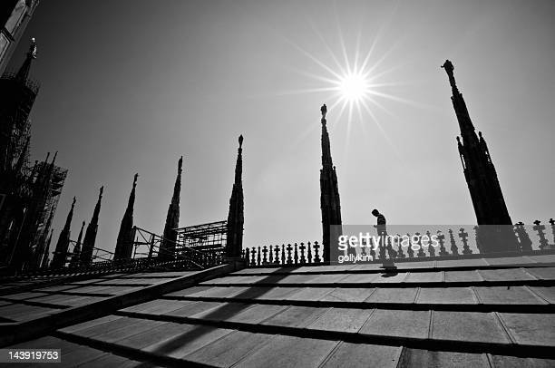 man walking at the roof terrace of duomo di milano - spire stock pictures, royalty-free photos & images