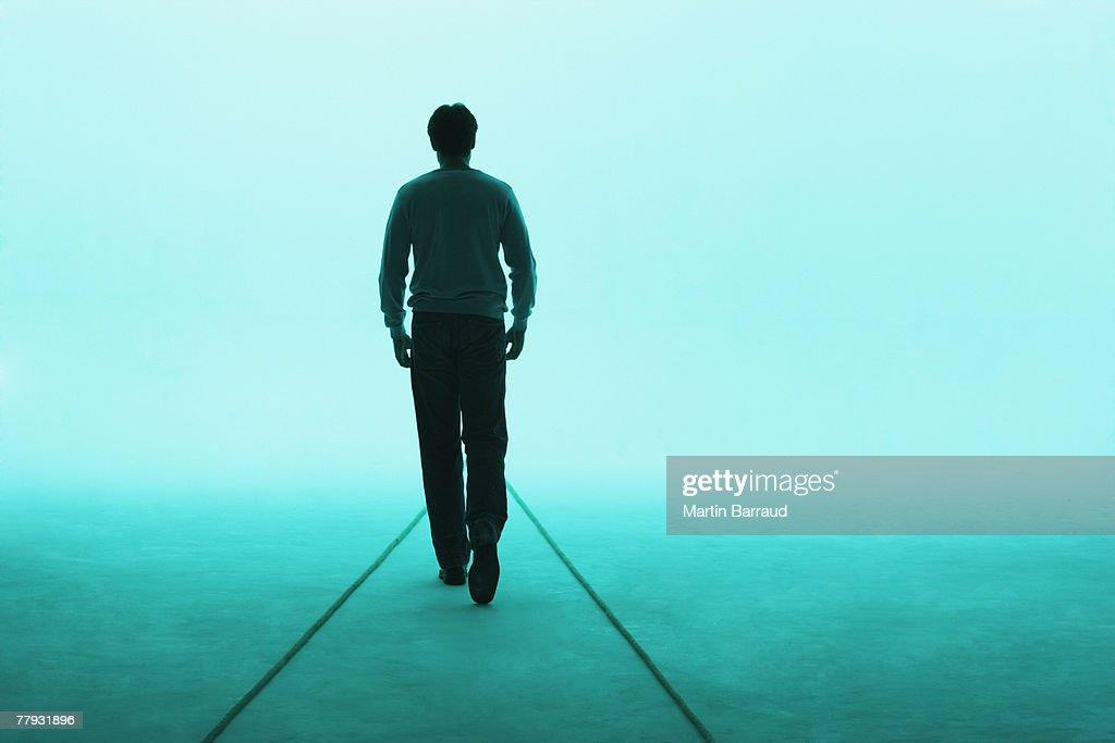 Man walking away : Stock Photo