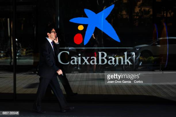 A man walking by a Caixa Bank office on May 17 2017 in Barcelona Spain 'n'n