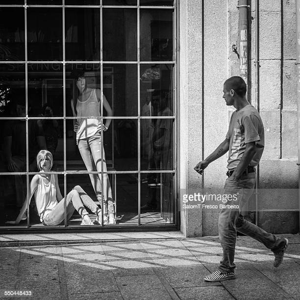Man walking by a shop window