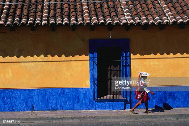 Man Walking by Colorful Facade