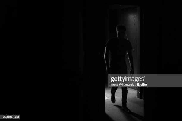 Man Walking By Door