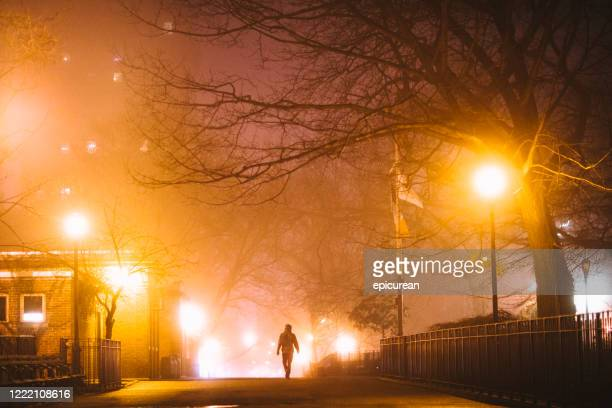 man walking down empty street in new york city - east village stock pictures, royalty-free photos & images