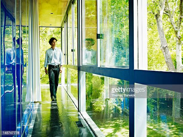 Man walking down hallway of home
