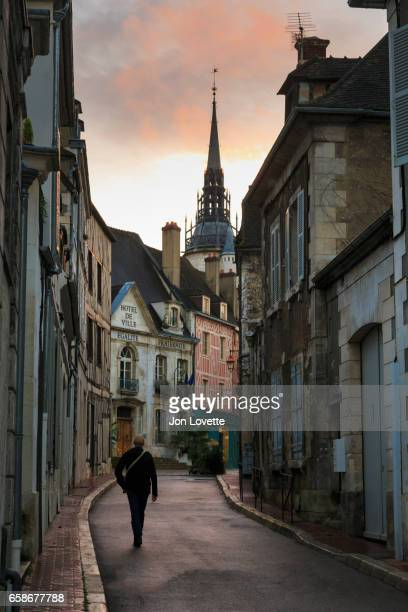 Man walking down Narrow Street in French Village