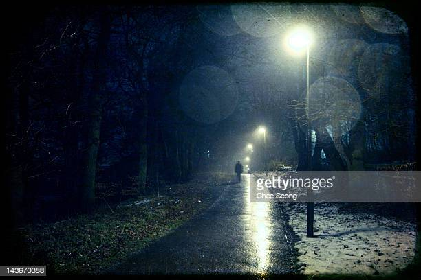 Man walking down quiet lane
