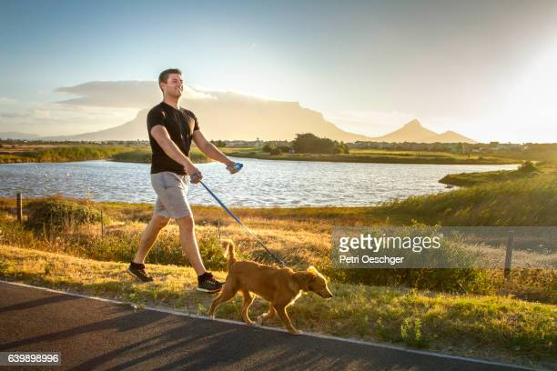 Man walking his dog.
