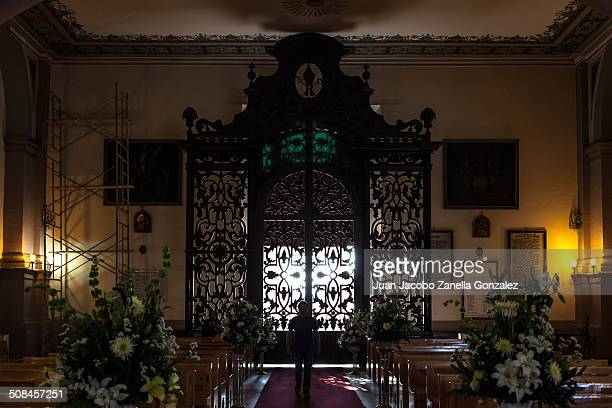 Man walking in a dark church interior