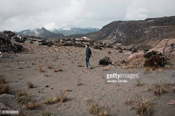 man walking in a volcanic lava field - nevado del ruiz stock photos and pictures