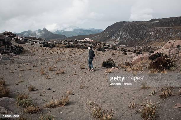 man walking in a volcanic lava field - nevado del ruiz fotografías e imágenes de stock