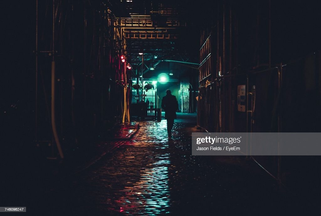 Man Walking In Alley At Night : Stock Photo