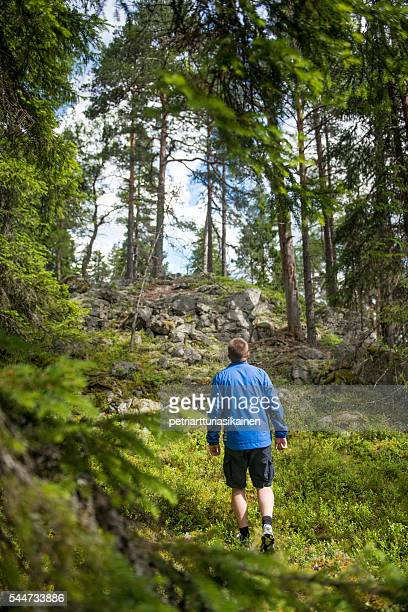 Man walking in forest.