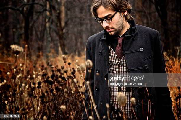 man walking in garden - long coat stock pictures, royalty-free photos & images