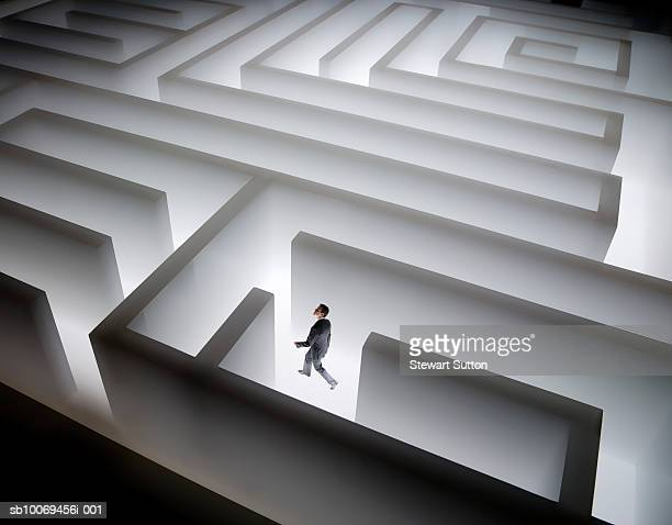 Man walking in giant maze