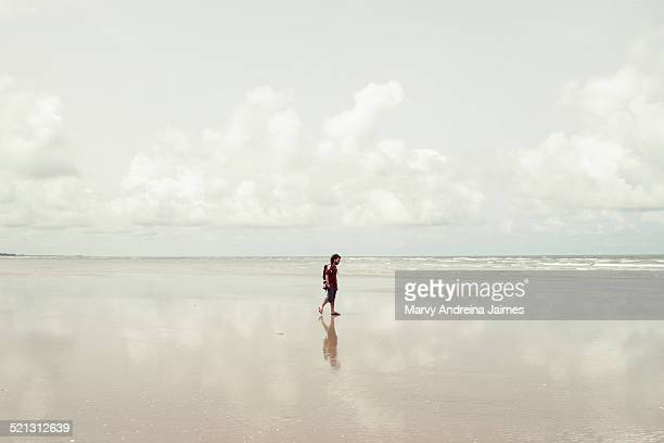 man walking in kartong beach - gambia stock photos and pictures