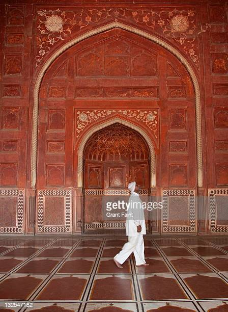 man walking in mosque. - interior of taj mahal stock pictures, royalty-free photos & images