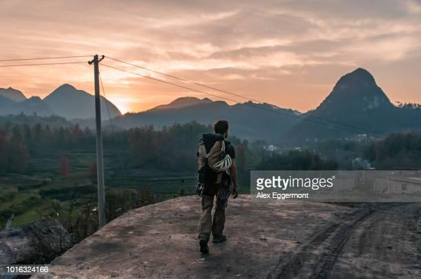 man walking in national park of getu he, guiyang, guizhou, china - guiyang stock pictures, royalty-free photos & images