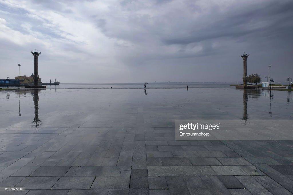 Man walking in republic square on a rainy day,Izmir. : Stock Photo