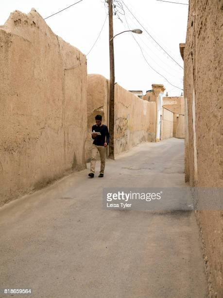 OLD CITY KASHAN ISFAHAN IRAN A man walking in the back streets of Kashan Iran One of the oldest inhabited cities in Iran Kashan dates back to...