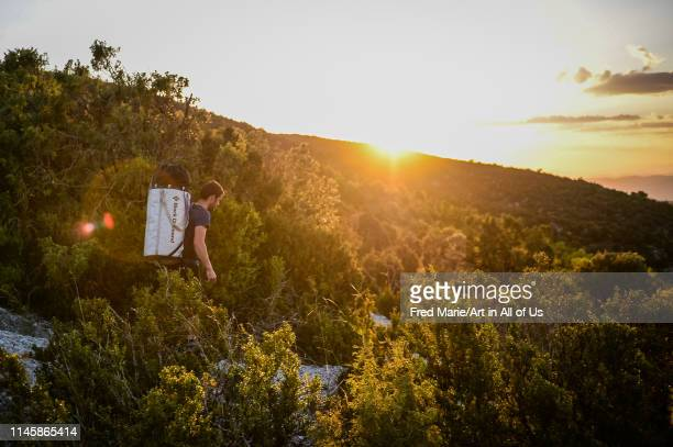 A man walking in the mountains in order to do rope jump Huesca Puente de montañana Spain on May 14 2014 in Puente De Montañana Spain